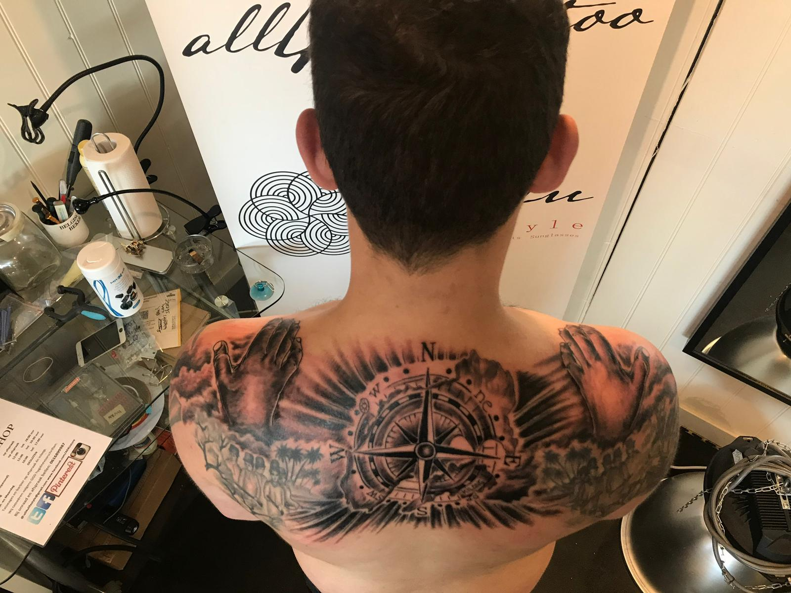 black n' grey backpiece tattoo